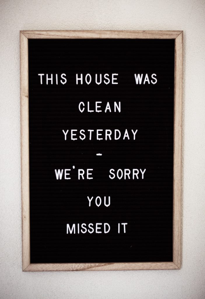 Black peg letter board with wodden edge and message on it
